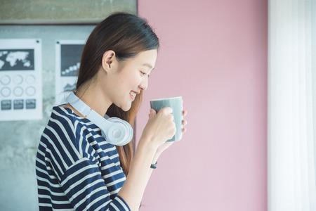 Beautiful asian woman drinking coffee Stock Photo