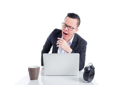 Asian businessman yawning between working