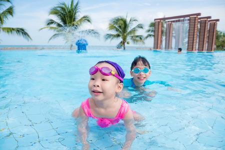 Asian children in swimming pool