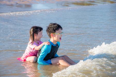 Asian children playing on beach