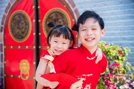 Happy chinese children smiling at camera