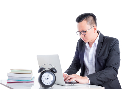 Asian businessman working over white