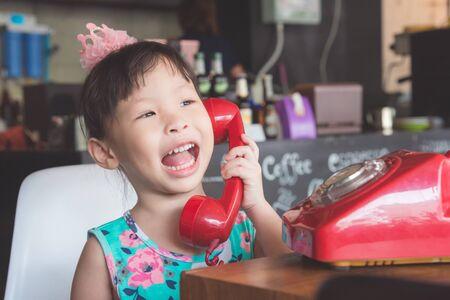 Little girl using telephone