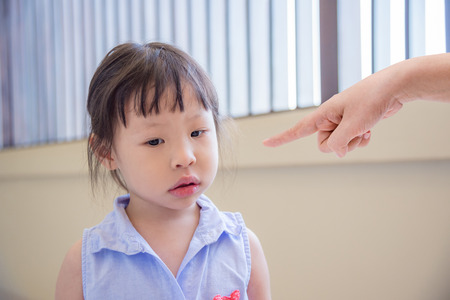 Little girl scolded by her parent