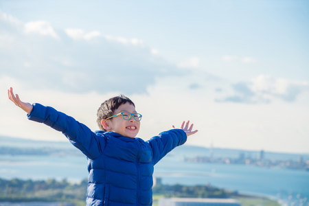 Young asian boy smiling on hill Stock Photo