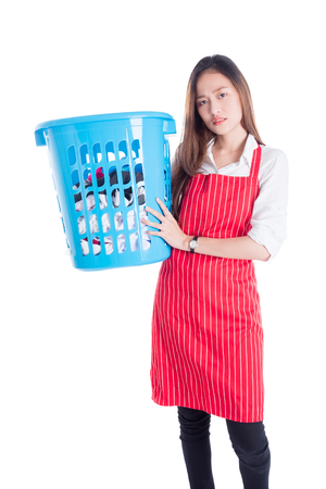 Beautiful asian girl holding clothes basket over white