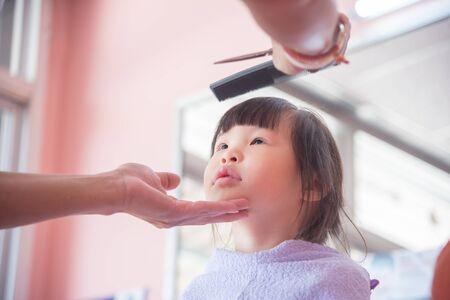 Little asian girl in salon