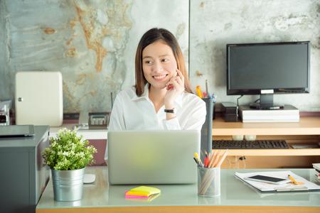 Beautiful asian woman working in office Stock Photo