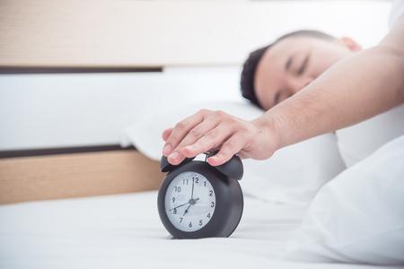 sleeping man and a clock Stock Photo