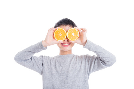 Young boy smiling with orange Stock Photo