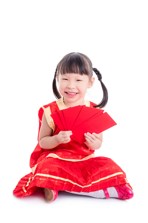 Little Chinese girl smiling on floor