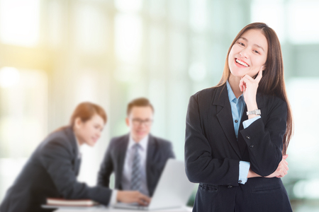 Beautiful young asian businesswoman smiling in office Stock Photo
