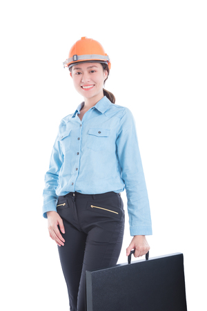Beautiful engineer woman wearing helmet and holding bag smiling over white background