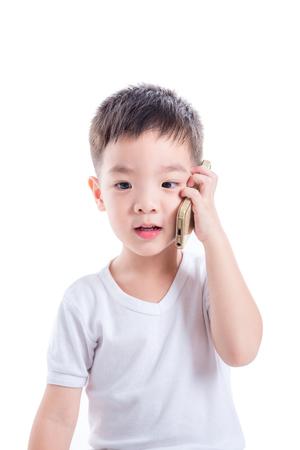 Little asian boy using mobile phone