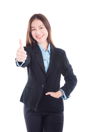 Beautiful asian businesswoman in black suit showing thumb up and smiles over white background