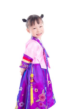 little asian girl wearing korean traditional costume standing over white background