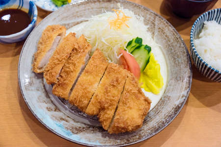 Tonkatsu,Japanese style deep fried pork with vegetables, rice,sauce and soup.
