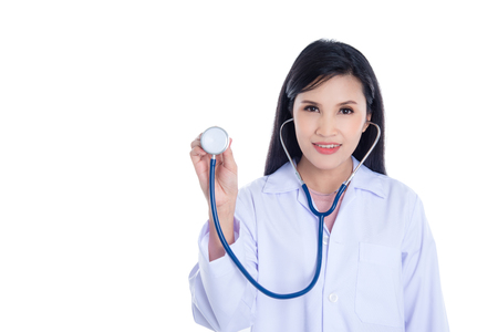 Beautiful asian doctor holding stethoscope with smile over white background Stock Photo