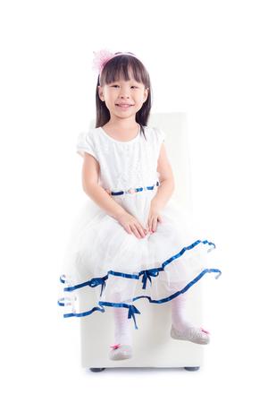 Little asian girl sitting on chair