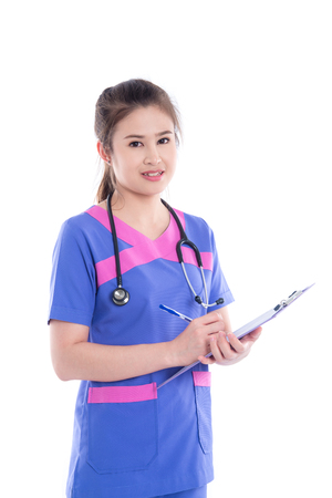 Beautiful asian nurse holding patients chart and smiling at camera