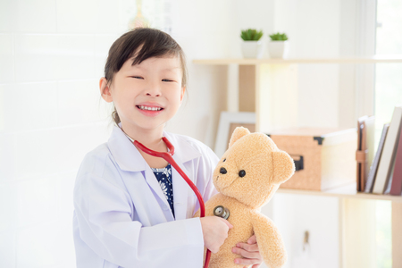 Little girl pretend to be doctor