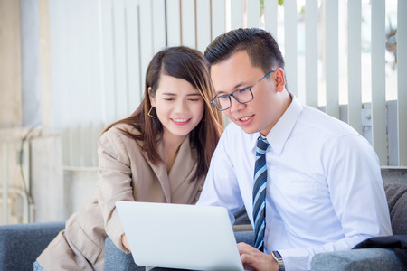 Young asian businessman talking about work with his partner in office
