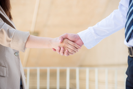 Hands of businesspeople shaking hand after agreement success Stock Photo
