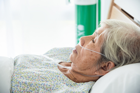 Closeup senior female patient sleeping on bed in hospital