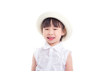 Little asian girl wearing hat and smiles over white background