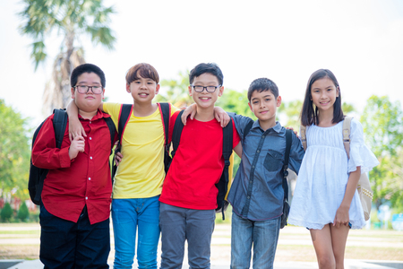 Group of asian student smiling in school park
