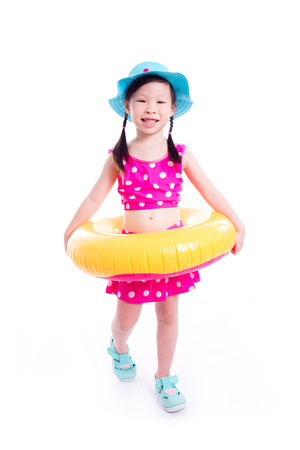 Little asian girl in swim suit smiling over white background