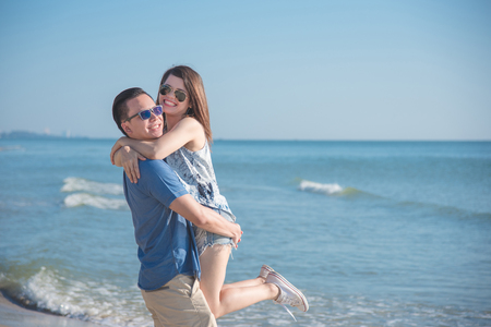 Young asian couple happy on the beach Stock Photo