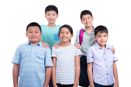 Group of asian children smiling over white background