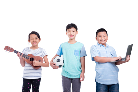Three asian children smiling over white background