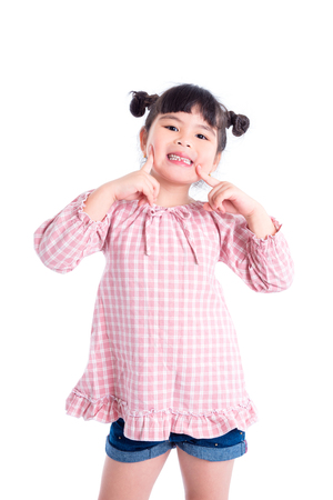 Little asian girl smile and show her first teeth loss over white background