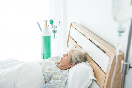 Senior female patient sleeping on bed in hospital