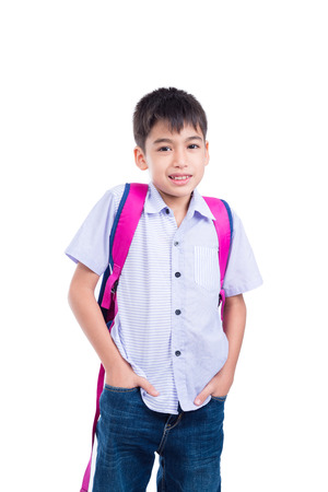 Young asian boy with backpack smiling over white background