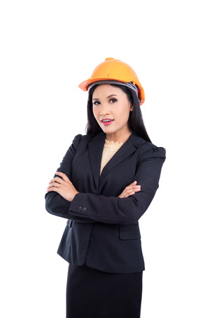 Beautiful asian engineer in black suit wearing helmet isolated over white background
