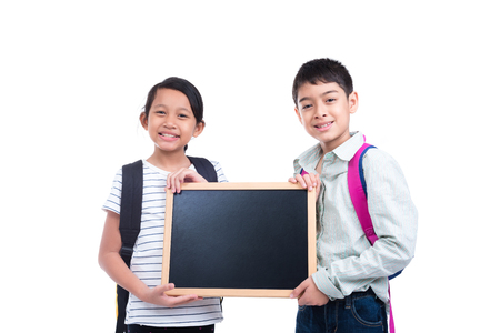 children holding empty chalkboard smiling over white background