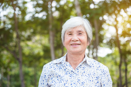Healthy senior asian woman smiling in park