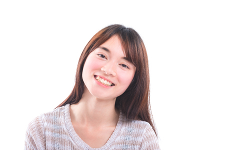 Beautiful young asian girl smiling over white background Stock Photo
