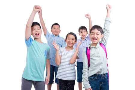 Group of happy asian children over white background