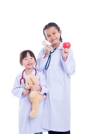 Young asian children pretend to be doctor standing over white background