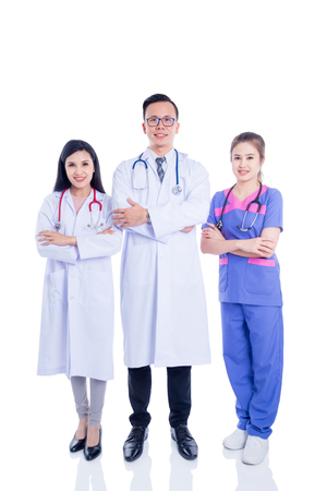Group of young asian medical team standing isolated over white background