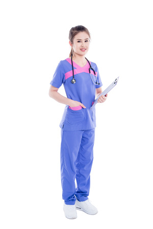 Full length of beautiful asian nurse standing over white background
