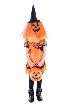 Full length of Little girl wearing Halloween costume standing over white background Stock Photo