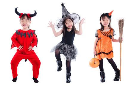 Little asian girl wearing Halloween costume standing over white background