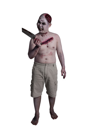 Male zombie holding knife and standing over white background