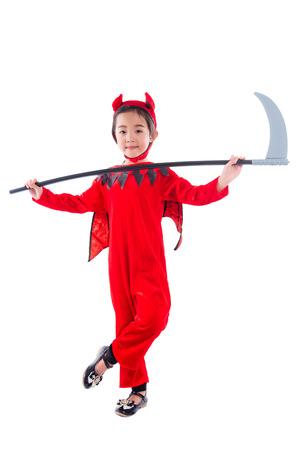 Full length of little asian cute girl standing in red evil Halloween costume over white background
