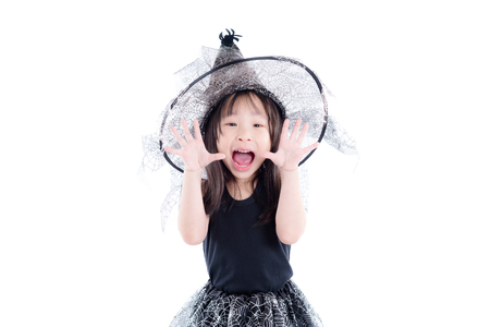 Little asian girl wearing witch costume for Halloween isolated over white background
